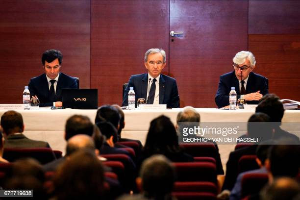 Group chief executive officer Bernard Arnault flanked by LVMH Group General manager Florian Ollivier and LVMH Group chief financial officer...