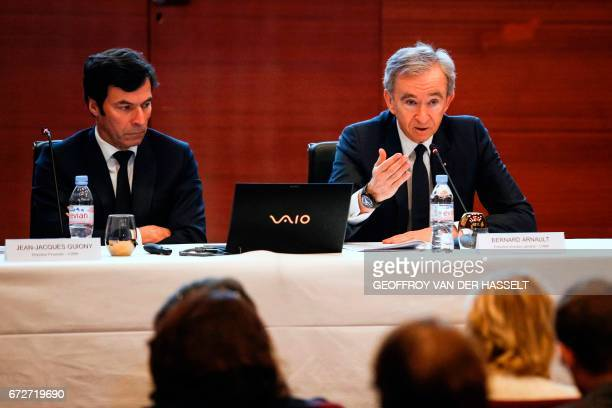 Group chief executive officer Bernard Arnault flanked by LVMH Group chief financial officer JeanJacques Guiony gives a press conference on April 25...