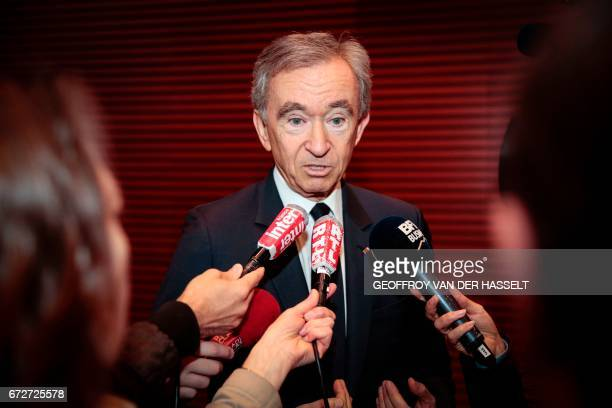 Group chief executive officer Bernard Arnault speaks to journalists after a press conference on April 25 2017 in Paris LVMH which already owns...
