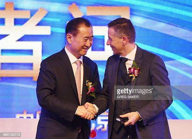 Wang Jianlin chairman of Wanda Group shakes hands with Philippe Blatter president and CEO of sports marketing company Infront after a press...