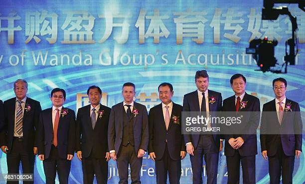 Wang Jianlin Chairman of Wanda Group and Philippe Blatter President and CEO of sports marketing company Infront pose for photos during a ceremony in...