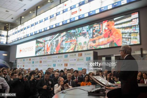 Billionaire Abilio Diniz right speaks during the initial public offering of Atacadao SA the Brazilian unit of French retailerCarrefour SA at Brasil...