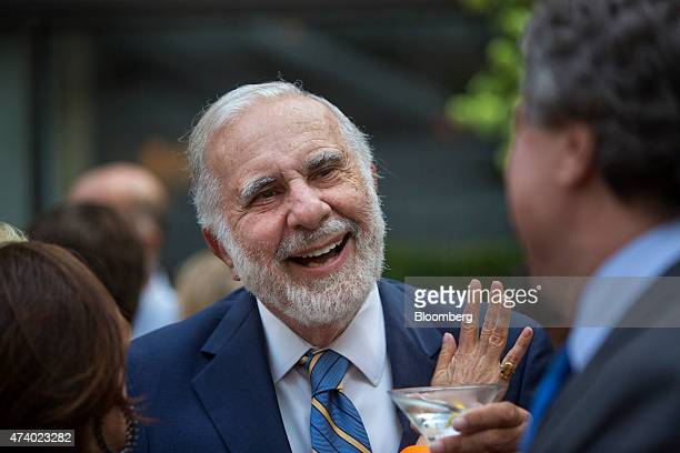 Billionaire activist investor Carl Icahn speaks with attendees during the Leveraged Finance Fights Melanoma charity event in New York US on Tuesday...