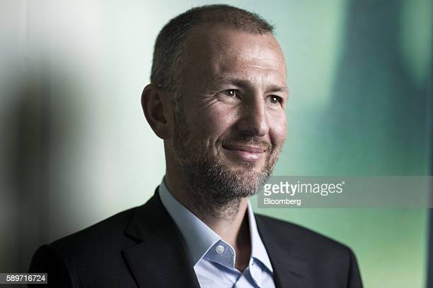 Billionaire Andrey Melnichenko owner of EuroChem Group AG poses for a photograph in London UK on Monday Aug 15 2016 EuroChem Group AGs new mines in...