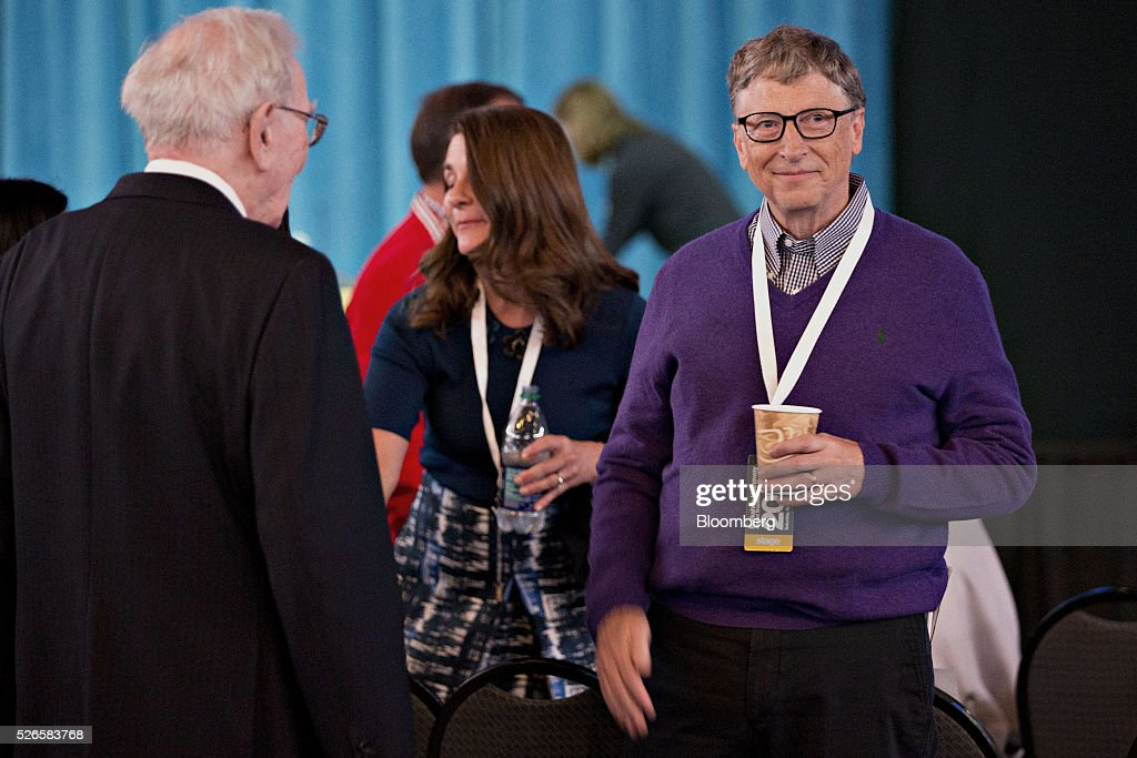 Billionaire <a gi-track='captionPersonalityLinkClicked' href=/galleries/search?phrase=Bill+Gates&family=editorial&specificpeople=202049 ng-click='$event.stopPropagation()'>Bill Gates</a>, chairman and founder of Microsoft Corp. and Berkshire Hathaway board member, right, stands with his wife <a gi-track='captionPersonalityLinkClicked' href=/galleries/search?phrase=Melinda+Gates&family=editorial&specificpeople=224902 ng-click='$event.stopPropagation()'>Melinda Gates</a>, center, and <a gi-track='captionPersonalityLinkClicked' href=/galleries/search?phrase=Warren+Buffett&family=editorial&specificpeople=533069 ng-click='$event.stopPropagation()'>Warren Buffett</a>, chairman and chief executive officer of Berkshire Hathaway Inc., ahead of the Berkshire Hathaway Inc. annual shareholders meeting in Omaha, Nebraska, U.S., on Saturday, April 30, 2016. Dozens of Berkshire Hathaway Inc. subsidiaries will be showing off their products as Chief Executive Officer <a gi-track='captionPersonalityLinkClicked' href=/galleries/search?phrase=Warren+Buffett&family=editorial&specificpeople=533069 ng-click='$event.stopPropagation()'>Warren Buffett</a> hosts the company's annual meeting. Photographer: Daniel Acker/Bloomberg via Getty Images