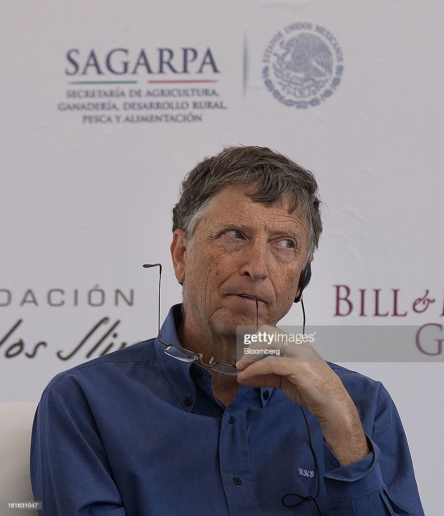 Billionaire Bill Gates listens during a news conference with Carlos Slim, unseen, to announce donations to Mexico's International Maize and Wheat Improvement Center, known by its Spanish initials as CIMMYT, in Texcoco, Mexico, on Wednesday, Feb. 13, 2013. The group, which performs research for agricultural productivity, will open its research facility this week. Photographer: Susana Gonzalez/Bloomberg via Getty Images