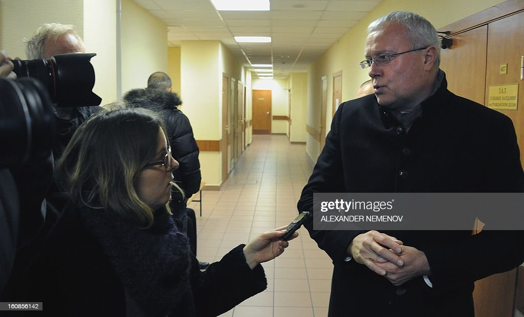 Billionaire businessman Alexander Lebedev (R) speaks to journalists as he arrives in a court in Moscow, on February 7, 2013. Lebedev, co-owner of the opposition Novaya Gazeta newspaper and supporter of Britain's The Independent and Evening Standard dailies arrived today in a Moscow court for a hearing on his charges of punching a property developer on a TV show in 2011.