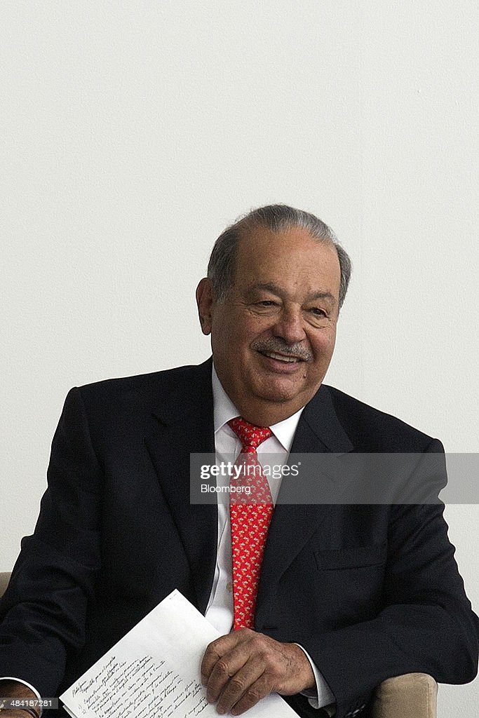 Billionaire <a gi-track='captionPersonalityLinkClicked' href=/galleries/search?phrase=Carlos+Slim&family=editorial&specificpeople=584959 ng-click='$event.stopPropagation()'>Carlos Slim</a>, chairman emeritus of America Movil SAB and Telefonos de Mexico SAB, smiles during the opening ceremony for the Digital Village in Mexico City, Mexico, on Friday, April 11, 2014. Telefonos de Mexico SAB (Telmex) installed more than 125 kilometers of fiber optic cable to create a network in the Zocalo where attendees can participate in a wide variety of free activities consisting of courses, workshops, conferences, contests and IT project incubation. Photographer: Susana Gonzalez/Bloomberg via Getty Images