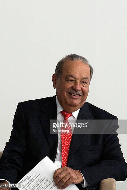 Billionaire Carlos Slim chairman emeritus of America Movil SAB and Telefonos de Mexico SAB smiles during the opening ceremony for the Digital Village...