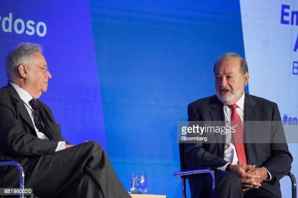 Billionaire Carlos Slim chairman emeritus of America Movil SAB and Telefonos de Mexico SAB right speaks while Fernando Henrique Cardoso former...