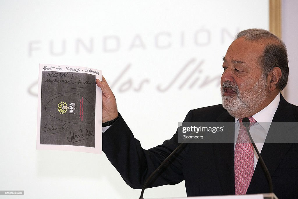 Billionaire Carlos Slim holds up an agreement he made with Salman Khan, founder of Khan Academy, unseen, in Mexico City, Mexico, on Monday, Jan. 14, 2013. Slim announced his support for Khan's not-for-profit website that offers free educational videos and teaching tools. Photographer: Susana Gonzalez/Bloomberg via Getty Images
