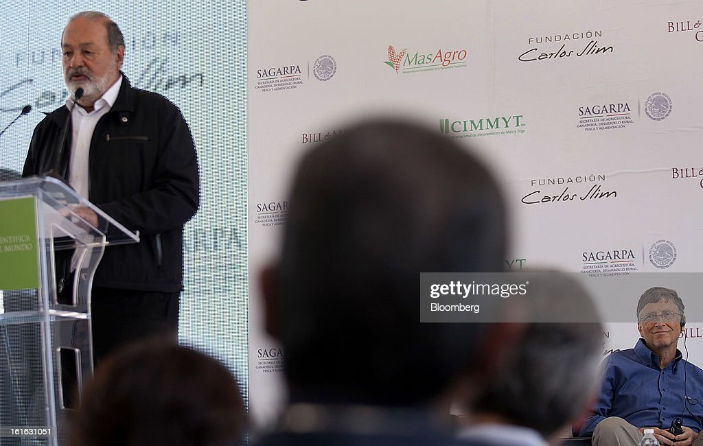 Billionaire Carlos Slim, left, speaks while Bill Gates listens during a news conference to announce donations to Mexico's International Maize and Wheat Improvement Center, known by its Spanish initials as CIMMYT, in Texcoco, Mexico, on Wednesday, Feb. 13, 2013. The group, which performs research for agricultural productivity, will open its research facility this week. Photographer: Susana Gonzalez/Bloomberg via Getty Images