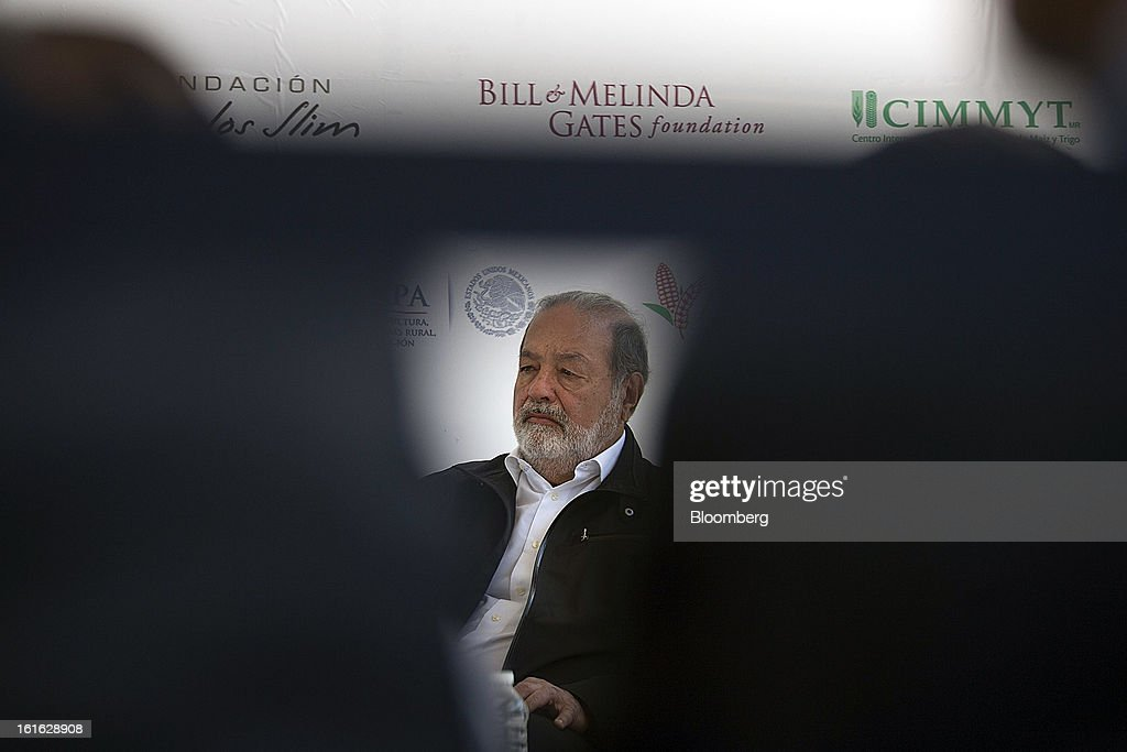 Billionaire Carlos Slim listens during a news conference with Bill Gates, unseen, to announce donations to Mexico's International Maize and Wheat Improvement Center, known by its Spanish initials as CIMMYT, in Texcoco, Mexico, on Wednesday, Feb. 13, 2013. The group, which performs research for agricultural productivity, will open its research facility this week. Photographer: Susana Gonzalez/Bloomberg via Getty Images