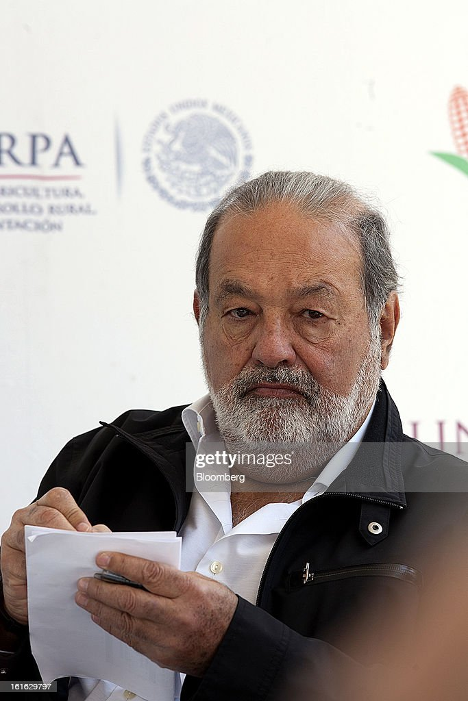 Billionaire <a gi-track='captionPersonalityLinkClicked' href=/galleries/search?phrase=Carlos+Slim&family=editorial&specificpeople=584959 ng-click='$event.stopPropagation()'>Carlos Slim</a> takes notes during a news conference with Bill Gates, unseen, to announce donations to Mexico's International Maize and Wheat Improvement Center, known by its Spanish initials as CIMMYT, in Texcoco, Mexico, on Wednesday, Feb. 13, 2013. The group, which performs research for agricultural productivity, opens its research facility this week. Photographer: Susana Gonzalez/Bloomberg via Getty Images