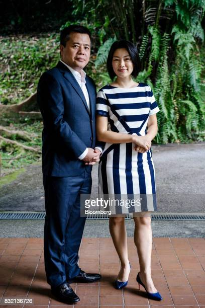 Billionaire Chen Tianqiao founder and chairman of Shanda Group left and his wife Chrissy Luo cofounder and vice chairman pose for a photograph in...