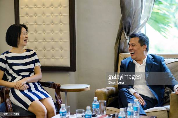 Billionaire Chen Tianqiao founder and chairman of Shanda Group right and his wife Chrissy Luo cofounder and vice chairman react during an interview...