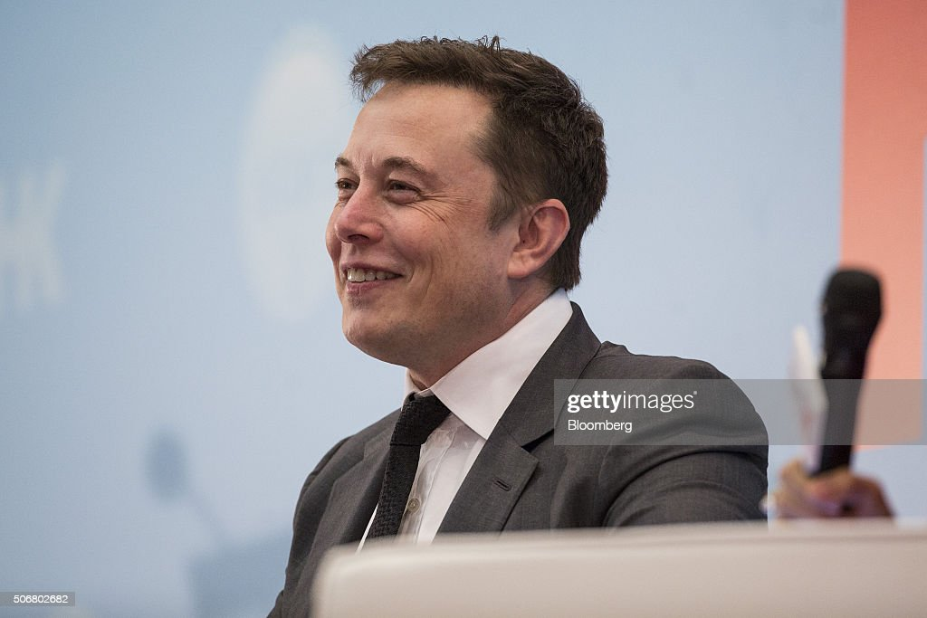 Billionaire Elon Musk, chief executive officer of Tesla Motors Inc., reacts during the StartmeupHK Venture Forum in Hong Kong, China, on Tuesday, Jan. 26, 2016. Tesla is looking for a Chinese production partner but is 'still trying to figure that out,' Musk said. Photographer: Justin Chin/Bloomberg via Getty Images