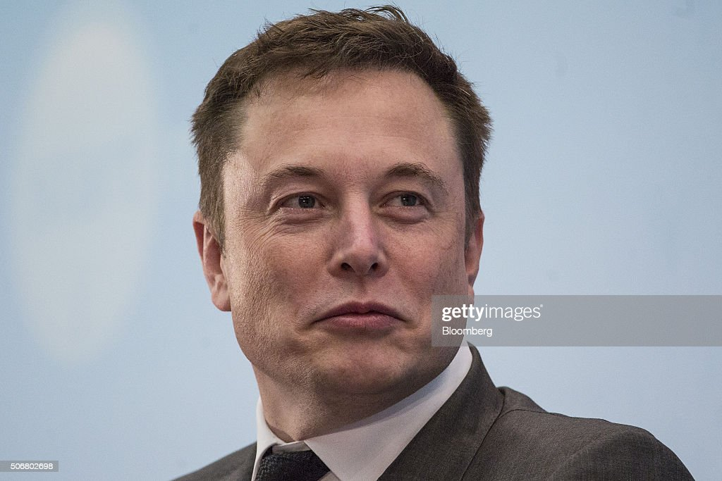 Billionaire Elon Musk, chief executive officer of Tesla Motors Inc., listens during the StartmeupHK Venture Forum in Hong Kong, China, on Tuesday, Jan. 26, 2016. Tesla is looking for a Chinese production partner but is 'still trying to figure that out,' Musk said. Photographer: Justin Chin/Bloomberg via Getty Images