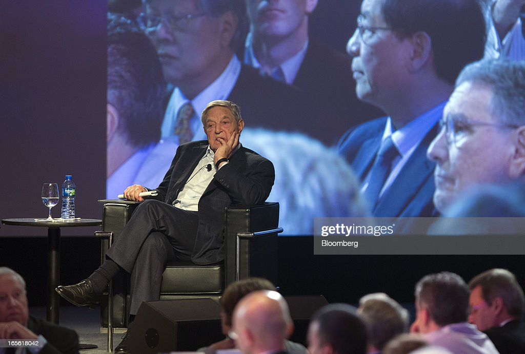 "Billionaire <a gi-track='captionPersonalityLinkClicked' href=/galleries/search?phrase=George+Soros&family=editorial&specificpeople=212841 ng-click='$event.stopPropagation()'>George Soros</a>, founder of Soros Fund Management LLC, attends a forum in Hong Kong, China, on Friday, April 5, 2013. The Bank of Japan's move to expand monetary easing may trigger ""an avalanche"" in the yen as Japanese put money elsewhere in anticipation of sustained currency depreciation, Soros said. Photographer: Jerome Favre/Bloomberg via Getty Images"