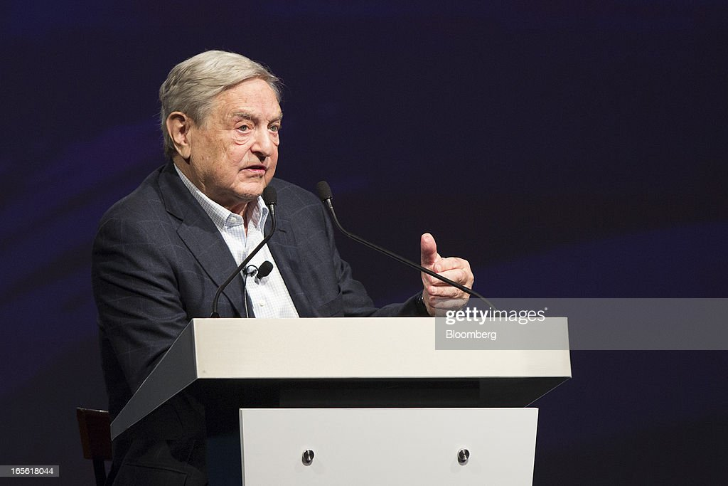 "Billionaire <a gi-track='captionPersonalityLinkClicked' href=/galleries/search?phrase=George+Soros&family=editorial&specificpeople=212841 ng-click='$event.stopPropagation()'>George Soros</a>, founder of Soros Fund Management LLC, speaks at a forum in Hong Kong, China, on Friday, April 5, 2013. The Bank of Japan's move to expand monetary easing may trigger ""an avalanche"" in the yen as Japanese put money elsewhere in anticipation of sustained currency depreciation, Soros said. Photographer: Jerome Favre/Bloomberg via Getty Images"