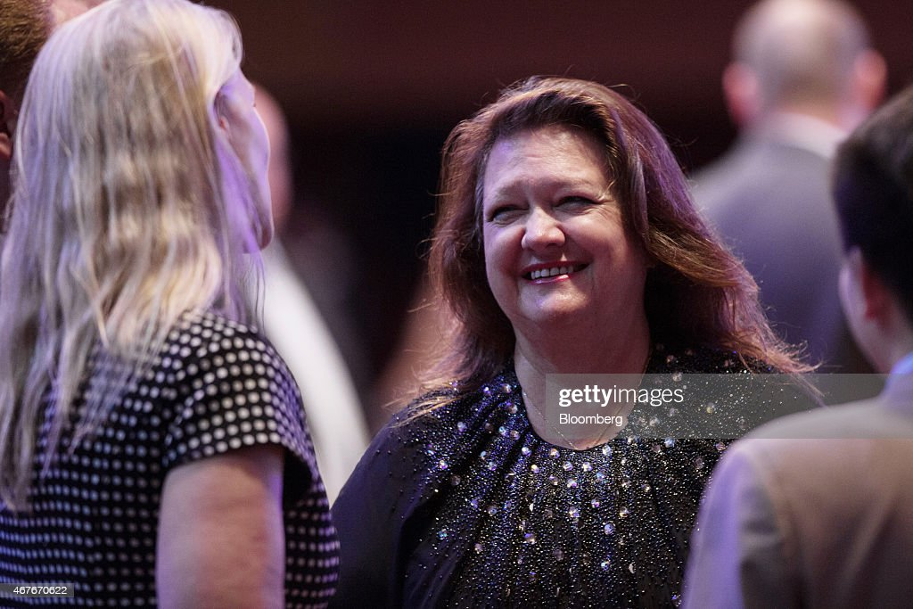 Billionaire <a gi-track='captionPersonalityLinkClicked' href=/galleries/search?phrase=Gina+Rinehart&family=editorial&specificpeople=6657657 ng-click='$event.stopPropagation()'>Gina Rinehart</a>, chairman of Hancock Prospecting Pty, center, speaks with attendees during the Mines and Money conference in Hong Kong, China, on Thursday, March 26, 2015. The conference runs through March 27. Photographer: Jerome Favre/Bloomberg via Getty Images