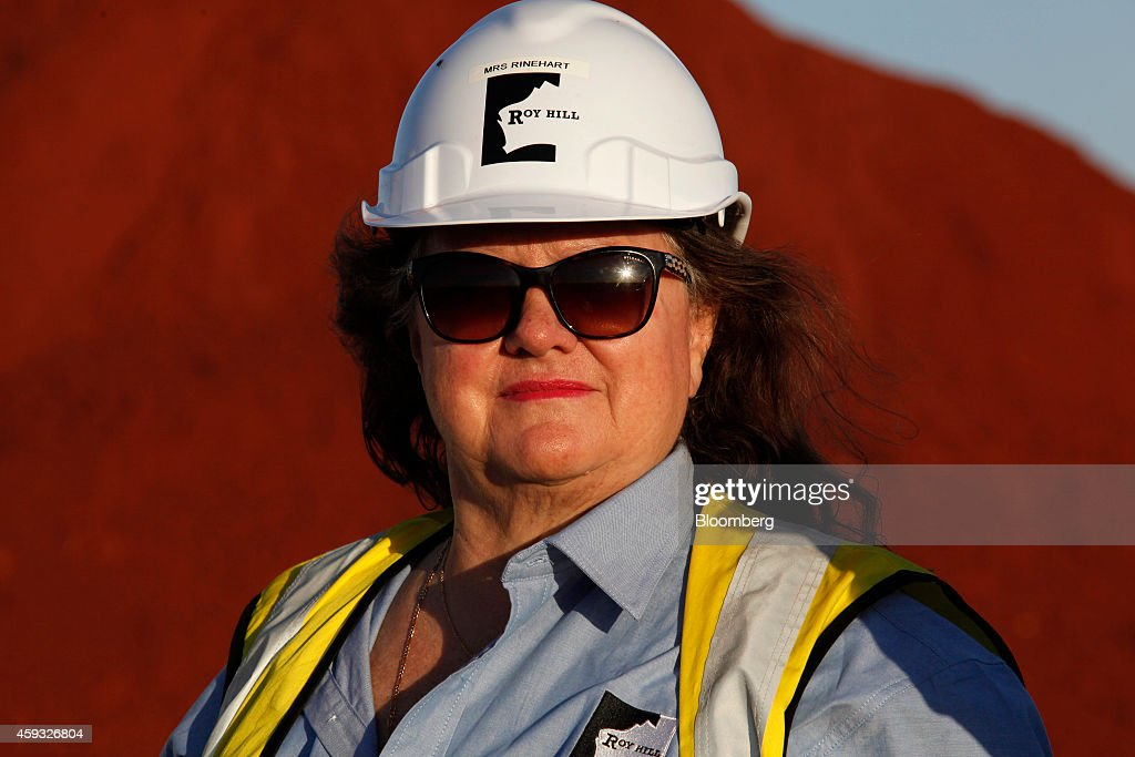 Billionaire <a gi-track='captionPersonalityLinkClicked' href=/galleries/search?phrase=Gina+Rinehart&family=editorial&specificpeople=6657657 ng-click='$event.stopPropagation()'>Gina Rinehart</a>, chairman of Hancock Prospecting Pty, stands for a photograph during a tour of the company's Roy Hill Mine operations under construction in the Pilbara region, Western Australia, on Thursday, Nov. 20, 2014. Rinehart, the Asia-Pacific's richest woman, is set to start exports in September from her new A$10 billion ($8.6 billion) iron ore mine undeterred by prices trading near five-year lows and forecast to extend losses. Photographer: Philip Gostelow/Bloomberg via Getty Images