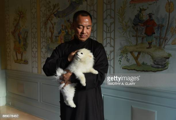 Billionaire Guo Wengui who is seeking asylum in the United States after accusing officials in his native China of corruption poses at his New York...