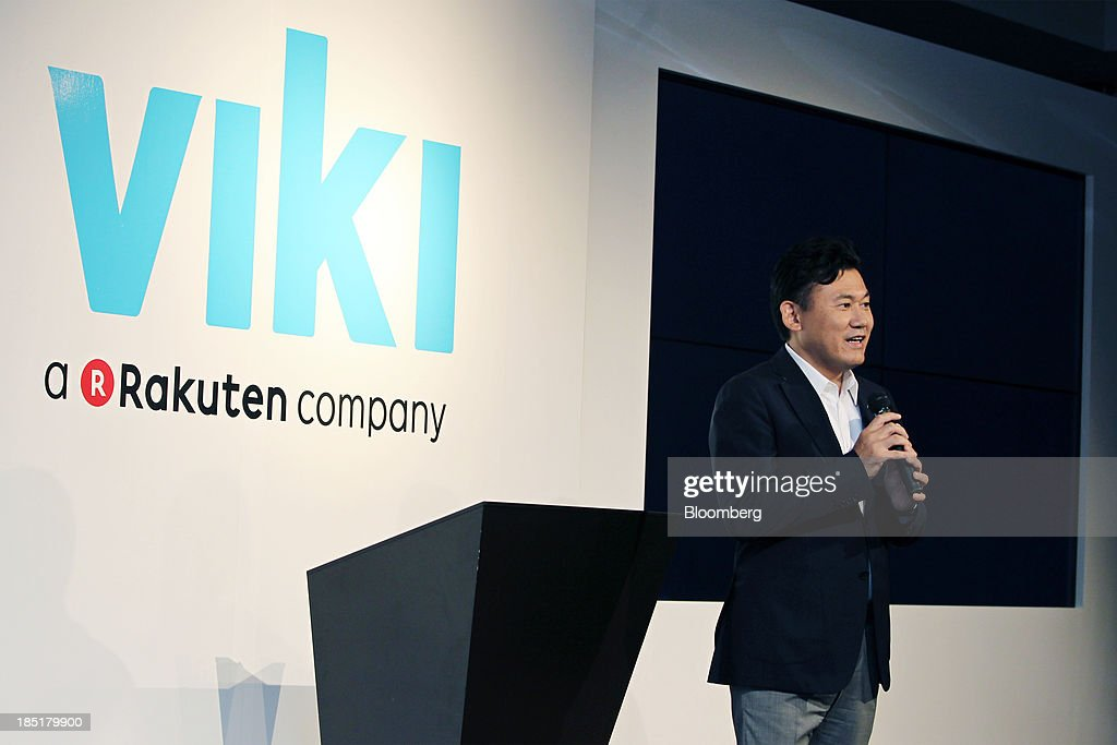 Billionaire <a gi-track='captionPersonalityLinkClicked' href=/galleries/search?phrase=Hiroshi+Mikitani&family=editorial&specificpeople=2208204 ng-click='$event.stopPropagation()'>Hiroshi Mikitani</a>, chairman and chief executive officer of Rakuten Inc., speaks during a news conference in Tokyo, Japan, on Friday, Oct. 18, 2013. Rakuten last month agreed to buy streaming video service provider Viki Inc. as the Japanese Internet retailer seeks to expand into new digital offerings. Photographer: Junko Kimura/Bloomberg via Getty Images