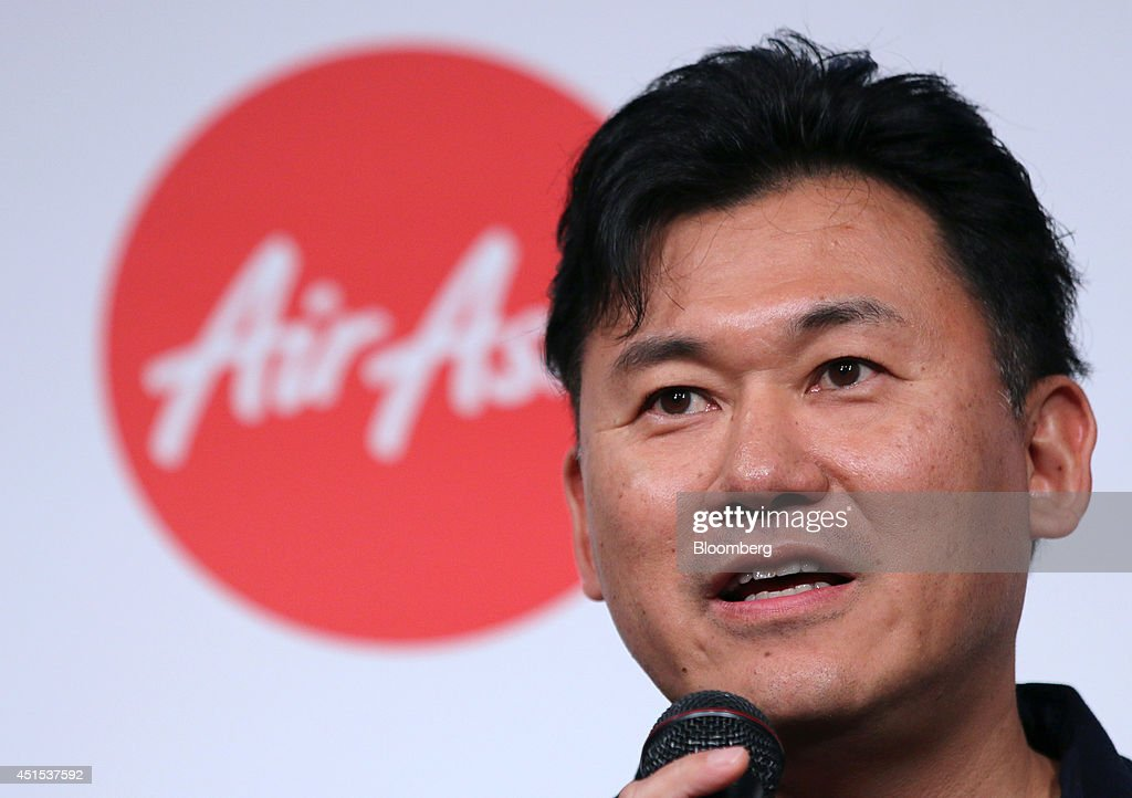 Billionaire <a gi-track='captionPersonalityLinkClicked' href=/galleries/search?phrase=Hiroshi+Mikitani&family=editorial&specificpeople=2208204 ng-click='$event.stopPropagation()'>Hiroshi Mikitani</a>, chairman and chief executive officer of Rakuten Inc., speaks during a news conference in Tokyo, Japan, on Tuesday, July 1, 2014. AirAsia, the region's biggest budget carrier, picked e-commerce company Rakuten for its second attempt at Japan's aviation market after pulling out of a tie-up with ANA Holdings Inc. last year. Photographer: Yuriko Nakao/Bloomberg via Getty Images