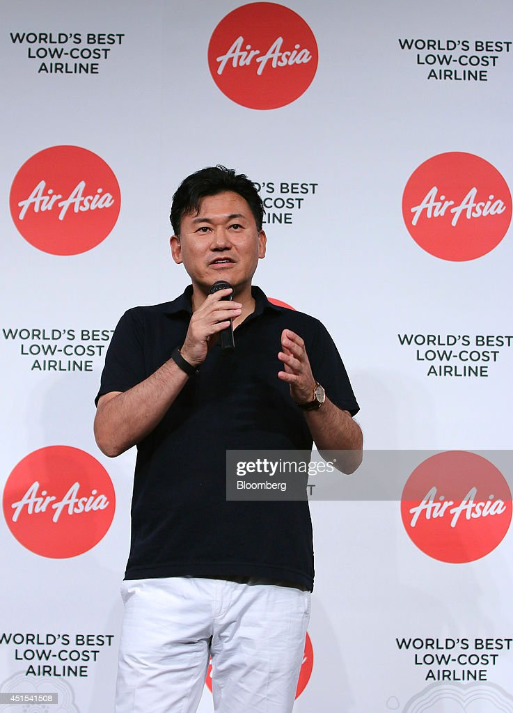 Billionaire <a gi-track='captionPersonalityLinkClicked' href=/galleries/search?phrase=Hiroshi+Mikitani&family=editorial&specificpeople=2208204 ng-click='$event.stopPropagation()'>Hiroshi Mikitani</a>, chairman and chief executive officer of Rakuten Inc., speaks during a news conference in Tokyo, Japan, on Tuesday, July 1, 2014. AirAsia Bhd., the region's biggest budget carrier, picked e-commerce company Rakuten for its second attempt at Japan's aviation market after pulling out of a tie-up with ANA Holdings Inc. last year. Photographer: Yuriko Nakao/Bloomberg via Getty Images