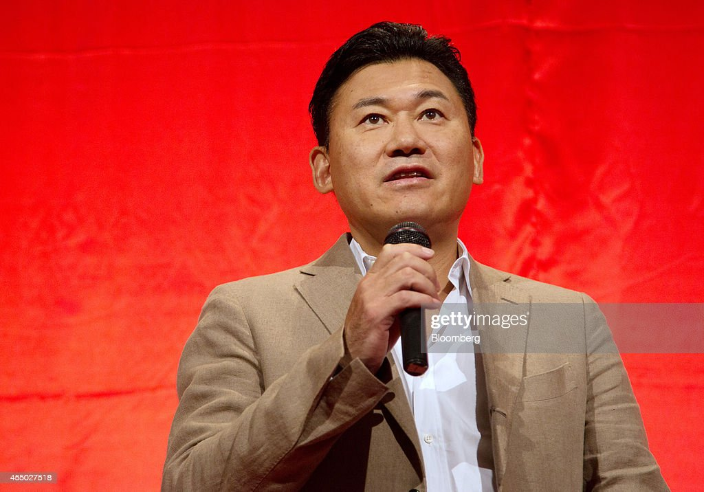 Billionaire <a gi-track='captionPersonalityLinkClicked' href=/galleries/search?phrase=Hiroshi+Mikitani&family=editorial&specificpeople=2208204 ng-click='$event.stopPropagation()'>Hiroshi Mikitani</a>, chairman and chief executive officer of Rakuten Inc., speaks during a news conference in Tokyo, Japan, on Tuesday, Sept. 9, 2014. Rakuten agreed to buy U.S. rebates website Ebates in Japan's largest e-commerce deal as the operator of the country's biggest online mall seeks overseas growth through acquisitions. Photographer: Noriyuki Aida/Bloomberg via Getty Images