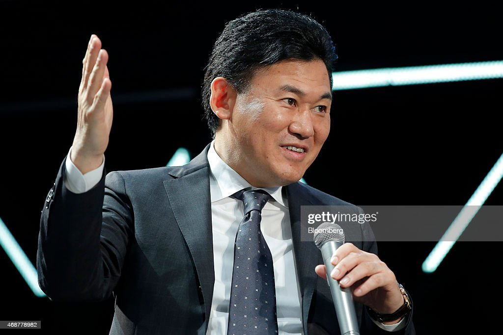 Billionaire <a gi-track='captionPersonalityLinkClicked' href=/galleries/search?phrase=Hiroshi+Mikitani&family=editorial&specificpeople=2208204 ng-click='$event.stopPropagation()'>Hiroshi Mikitani</a>, chairman and chief executive officer of Rakuten Inc. and representative director of the Japan Association of New Economy, speaks at the New Economy Summit 2015 in Tokyo, Japan, on Tuesday, April 7, 2015. The conference, organized by the Japan Association of New Economy, will be held through April 8. Photographer: Kiyoshi Ota/Bloomberg via Getty Images