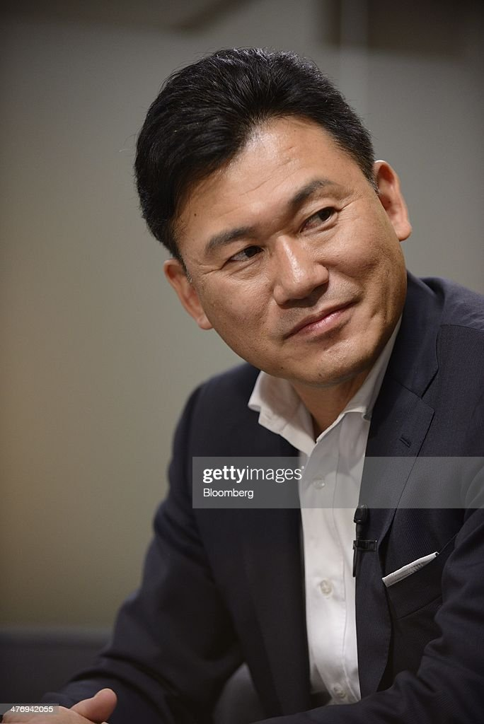 Billionaire <a gi-track='captionPersonalityLinkClicked' href=/galleries/search?phrase=Hiroshi+Mikitani&family=editorial&specificpeople=2208204 ng-click='$event.stopPropagation()'>Hiroshi Mikitani</a>, chairman and chief executive officer of Rakuten Inc., pauses during an interview in Tokyo, Japan, on Wednesday, March 5, 2014. Mikitani is plowing cash into technologies such as mobile applications and online video as he seeks to expand Rakuten beyond its core business as an online marketplace. Photographer: Akio Kon/Bloomberg via Getty Images