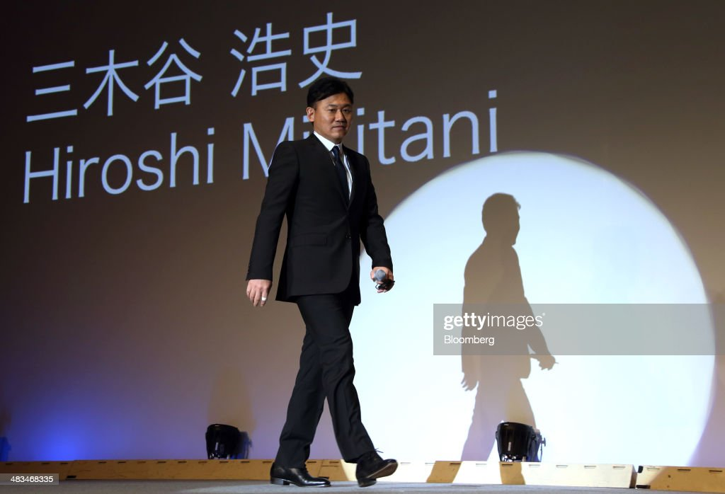 Billionaire <a gi-track='captionPersonalityLinkClicked' href=/galleries/search?phrase=Hiroshi+Mikitani&family=editorial&specificpeople=2208204 ng-click='$event.stopPropagation()'>Hiroshi Mikitani</a>, chairman and chief executive officer of Rakuten Inc. and representative director of the Japan Association of New Economy, arrives for the opening of the New Economy Summit in Tokyo, Japan, on Wednesday, April 9, 2014. The conference, hosted by the Japan Association of New Economy, will be held through April 10. Photographer: Tomohiro Ohsumi/Bloomberg via Getty Images
