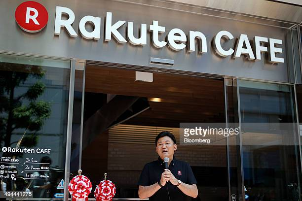 Billionaire Hiroshi Mikitani chairman and chief executive officer of Rakuten Inc speaks during the opening ceremony for the company's Rakuten Cafe in...