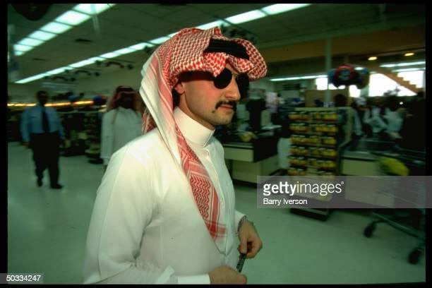 Billionaire investor Saudi Prince Alwaleed at supermarket