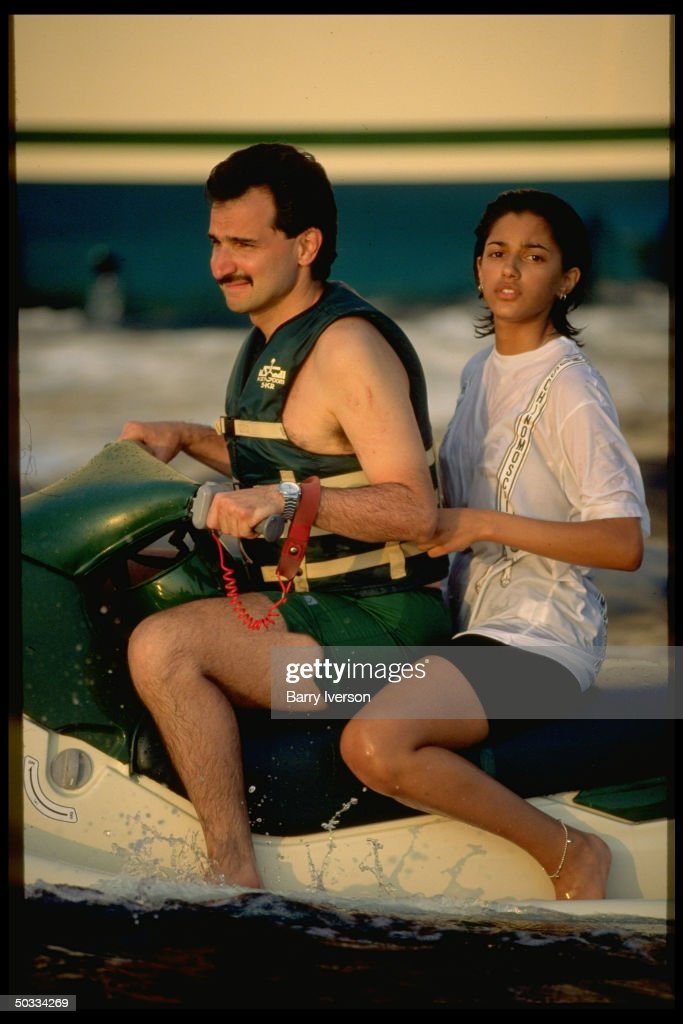 Billionaire investor Saudi Prince Alwaleed (Kingdom Holding Co.) jet skiing w. daughter Reem (off his yacht, Kingdom 5-KR, formerly owned by US real estate mogul Donald Trump).