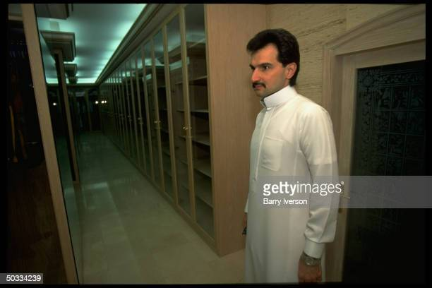 Billionaire investor Saudi Prince Alwaleed poised in hallway at his palace