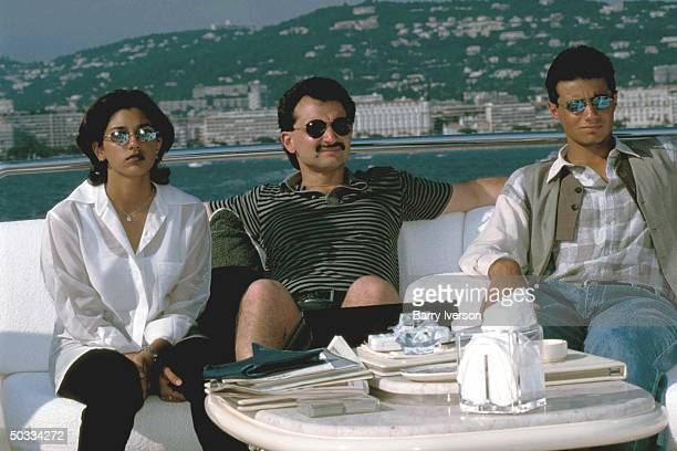 Billionaire investor Saudi Prince Alwaleed relaxing w daughter Reem son Khalid on his yacht Kingdom 5KR formerly owned by US real estate mogul Donald...