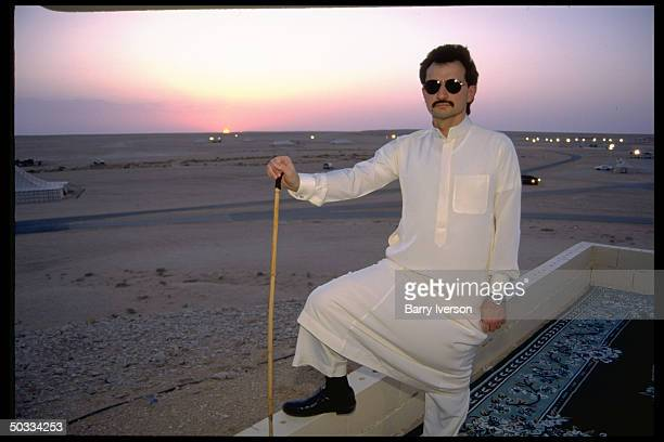 Billionaire investor Saudi Prince Alwaleed surveying sunset landscape at his weekend desert retreat 45 miles from Riyadh