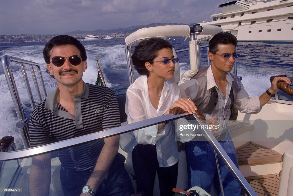 Billionaire investor Saudi Prince Alwaleed (Kingdom Holding Co.) taking daughter Reem & son Khalid on speedboat (launched his yacht, Kingdom 5-KR, formerly owned by US real estate mogul Donald Trump) ride.