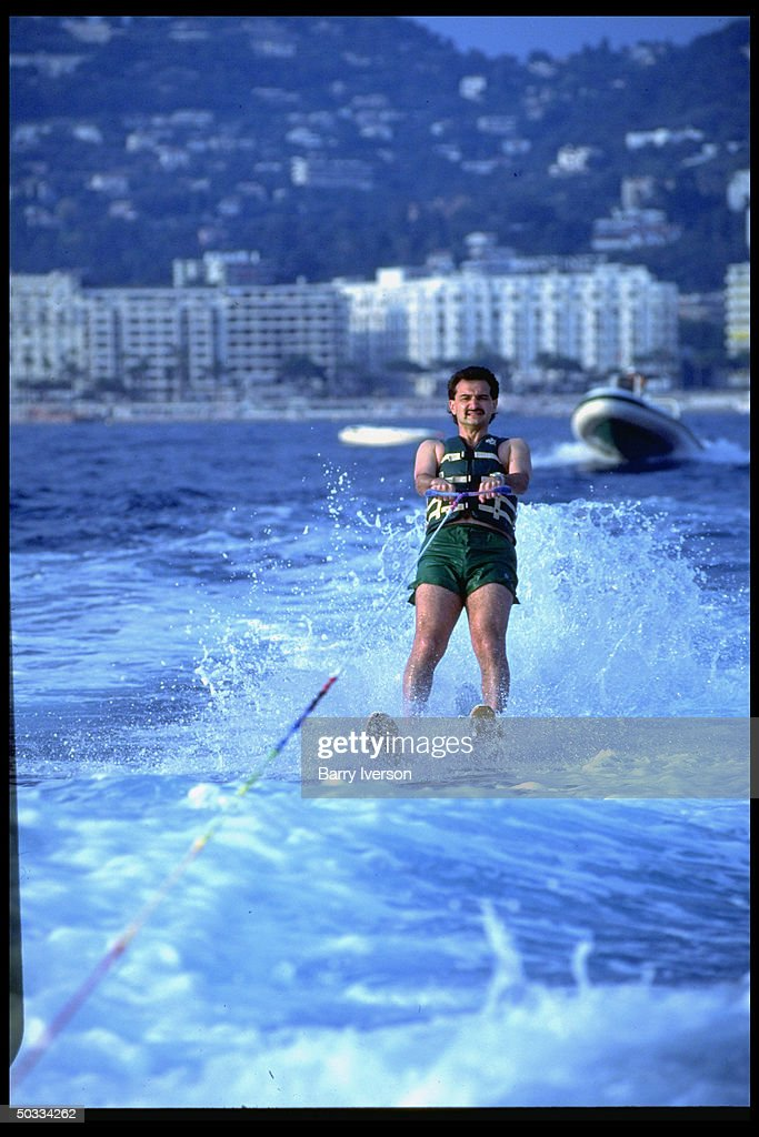 Billionaire investor Saudi Prince Alwaleed (Kingdom Holding Co.) water skiing (towed by boat launched from his yacht, Kingdom 5-KR, formerly owned by US real estate mogul Donald Trump).