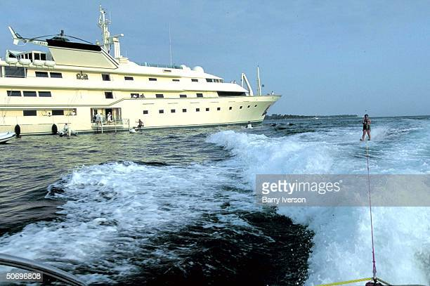 Billionaire investor Saudi Prince Alwaleed water skiing towed by boat launched from his yacht Kingdom 5KR formerly owned by US real estate mogul...