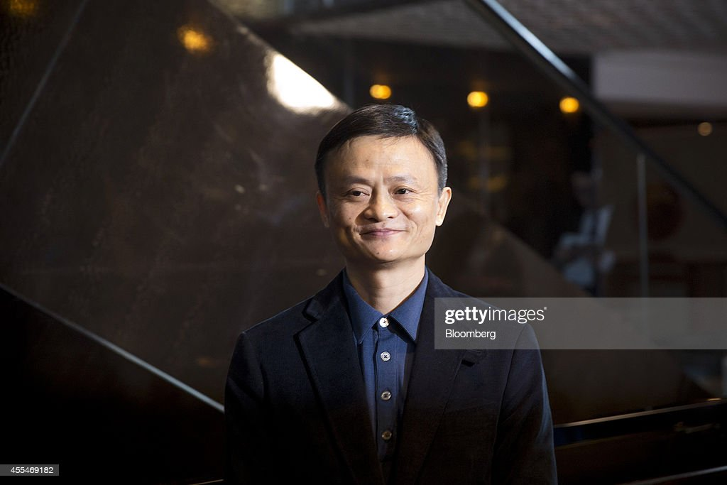 Billionaire <a gi-track='captionPersonalityLinkClicked' href=/galleries/search?phrase=Jack+Ma&family=editorial&specificpeople=2110288 ng-click='$event.stopPropagation()'>Jack Ma</a>, chairman of Alibaba Group Holding Ltd., poses for photographers after arriving for a meeting at the Ritz-Carlton hotel in Hong Kong, China, on Monday, Sept. 15, 2014. Alibaba, the e-commerce company whose fortunes surged along with China's economy, plans a historic U.S. initial public offering that may also claim the global record. Photographer: Brent Lewin/Bloomberg via Getty Images