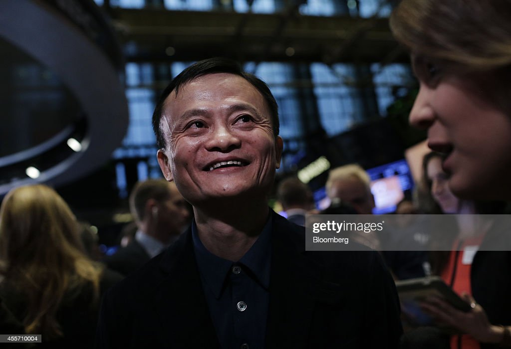 Billionaire <a gi-track='captionPersonalityLinkClicked' href=/galleries/search?phrase=Jack+Ma&family=editorial&specificpeople=2110288 ng-click='$event.stopPropagation()'>Jack Ma</a>, chairman of Alibaba Group Holding Ltd., smiles during a Bloomberg Television interview on the floor of the New York Stock Exchange (NYSE) in New York, U.S., on Friday, Sept. 19, 2014. Alibaba Group Holding Ltd., the e-commerce company started in 1999 with $60,000 cobbled together by Ma, cemented its status as a symbol of China's economic emergence by raising $21.8 billion in a U.S. initial public offering. Photographer: Scott Eells/Bloomberg via Getty Images