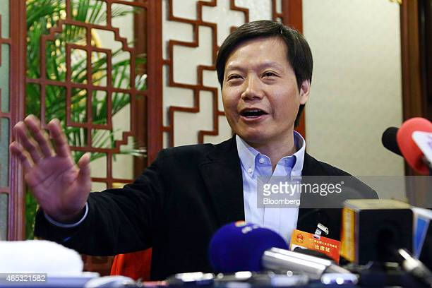 Billionaire Lei Jun chairman and chief executive officer of Xiaomi Corp gestures as he speaks during a news conference on the sidelines of the third...