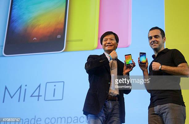 Billionaire Lei Jun chairman and chief executive officer of Xiaomi Corp left and Hugo Barra vice president of Global Operations at Xiaomi Corp hold...