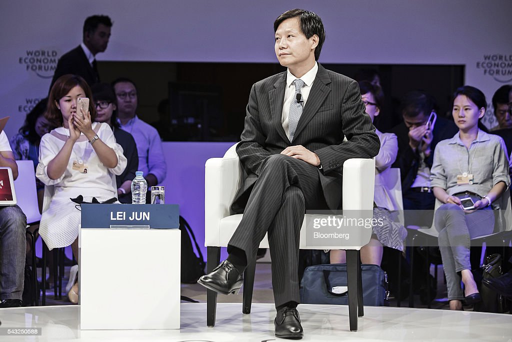 Billionaire <a gi-track='captionPersonalityLinkClicked' href=/galleries/search?phrase=Lei+Jun&family=editorial&specificpeople=7334031 ng-click='$event.stopPropagation()'>Lei Jun</a>, chairman and chief executive officer of Xiaomi Corp., attends a session at the World Economic Forum (WEF) Annual Meeting of the New Champions in Tianjin, China, on Monday, June 27, 2016. The meeting runs through June 28. Photographer: Qilai Shen/Bloomberg via Getty Images