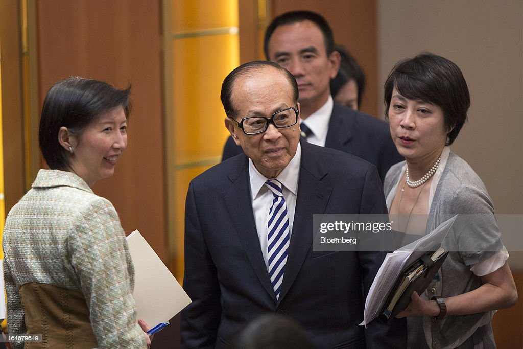 Billionaire Li Ka-shing, chairman of Cheung Kong (Holdings) Ltd. and Hutchison Whampoa Ltd., center, speaks with reporters after a news conference in Hong Kong, China, on Tuesday, March 26, 2013. Cheung Kong Holdings, the builder controlled by Asia's richest man, said 2012 profit excluding contributions from unit Hutchison Whampoa Ltd. rose 6 percent as rental income growth offset a decline in home sales. Photographer: Jerome Favre/Bloomberg via Getty Images