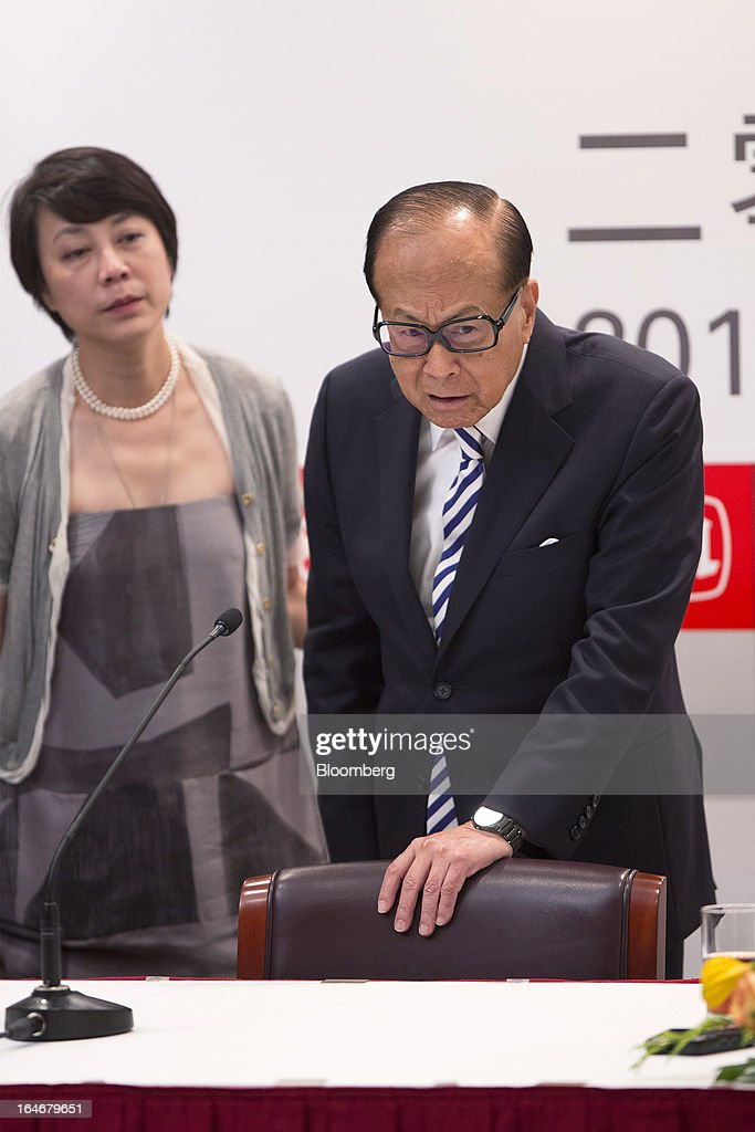 Billionaire Li Ka-shing, chairman of Cheung Kong (Holdings) Ltd. and Hutchison Whampoa Ltd., right, speaks with reporters after a news conference in Hong Kong, China, on Tuesday, March 26, 2013. Cheung Kong Holdings, the builder controlled by Asia's richest man, said 2012 profit excluding contributions from unit Hutchison Whampoa Ltd. rose 6 percent as rental income growth offset a decline in home sales. Photographer: Jerome Favre/Bloomberg via Getty Images